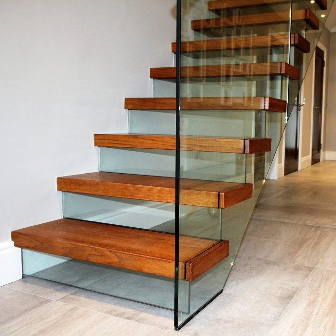 Floating modern stairs with glass riser