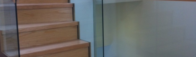 Oak Stairs with free standing glass balustrade