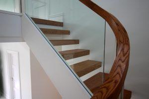 Curved handrail freestanding glass balustrade