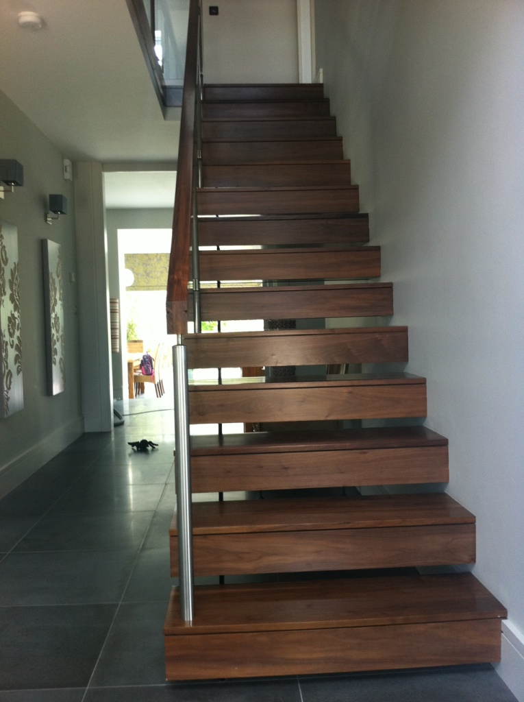 Floating Tread Stairs In Walnut Glass
