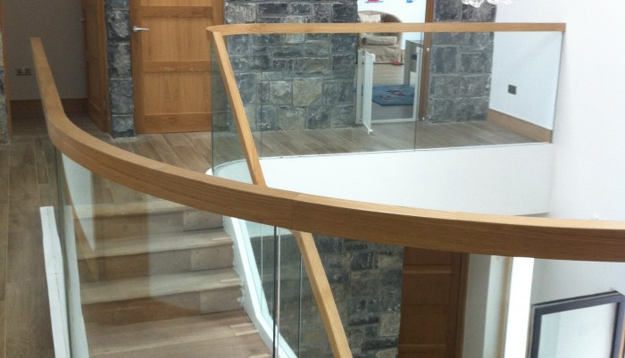 Curved Oak and Freestanding Glass Balastrade Staircase
