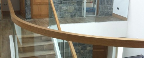 Curved Oak and Freestanding Glass Balustrade Staircase