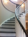 curved cut string stairs with painted risers