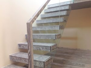 Floating oak stained treads stairs with glass balustrade