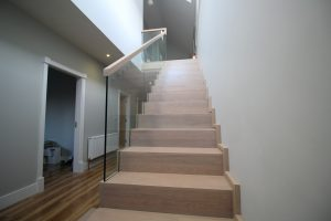 modern-cut-string-stairs-with-freestanding-glass-balustrade-12