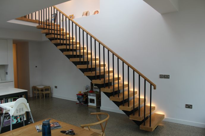 Mono string stairs with curved handrail