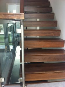 cantilevered stairs in walnut and glass