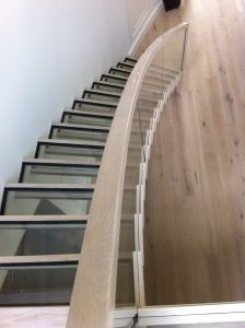 Stairs Ireland, curved cantilevered glass stairs in oak