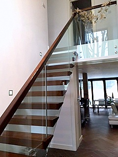 Dark Oak Floating Stairs With Glass Balustrade