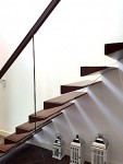 Modern Cantilever stairs with open risers and glass balustrade