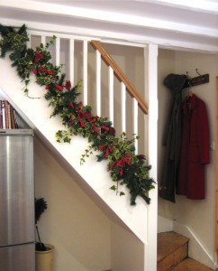 Traditional stairs with holly garland