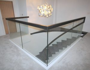 curved stairs with glass balcony