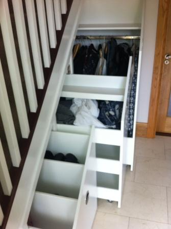traditional stairs with under stair storage
